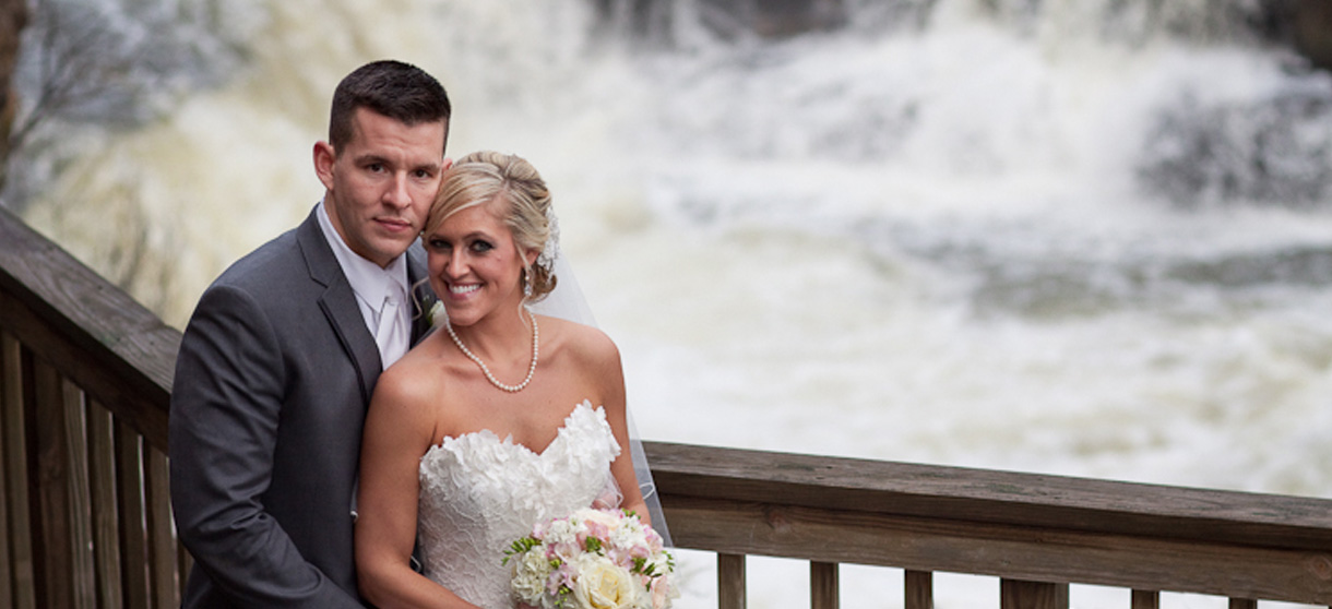 Couple with the falls in the background